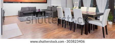 Dining table in luxury spacious living room