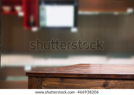 Dining table on blurred brown kitchen interior background.