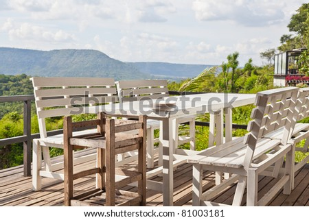 Dining table on terrace and, mountain view - stock photo