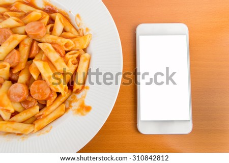 dinner and smartphone over table - stock photo