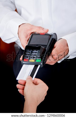 dinner in restaurant man and woman pay by credit card - stock photo