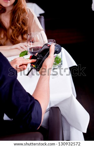 dinner in restaurant man and woman pay by credit card
