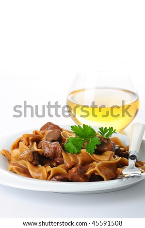 Dinner of tasty beef stroganoff on a white background. - stock photo
