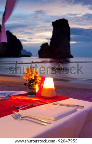 dinner on sunset at beach in Thailand - stock photo