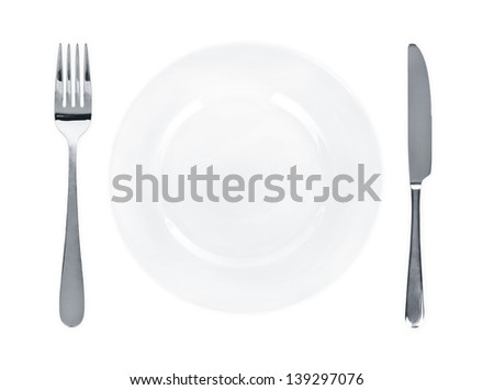 Dinner place setting. A white china plate with silver fork and knife isolated on white background. - stock photo