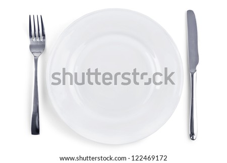 Dinner Place Setting. White Plate with Fork and Knife Isolated on White Background - stock photo