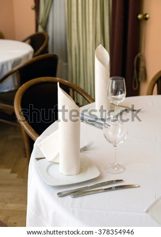 dinner plate on white table background in restaurant