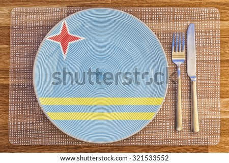Dinner plate with the flag of Aruba on it for your international food and drink concepts. - stock photo