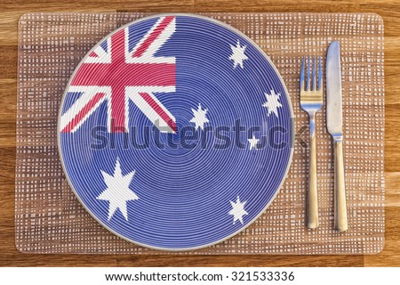 Dinner plate with the flag of Australia on it for your international food and drink concepts. - stock photo