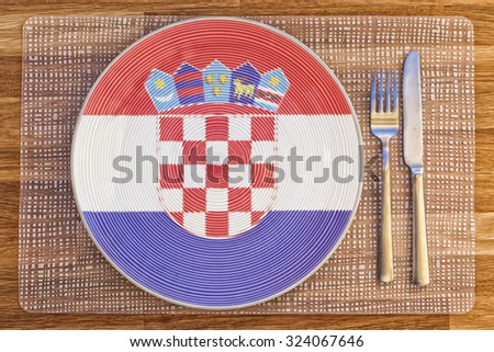 Dinner plate with the flag of Croatia on it for your international food and drink concepts. - stock photo