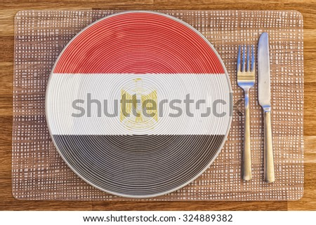 Dinner plate with the flag of Egypt on it for your international food and drink concepts. - stock photo