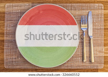 Dinner plate with the flag of Hungary on it for your international food and drink concepts. - stock photo