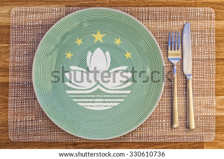 Dinner plate with the flag of Macau on it for your international food and drink concepts. - stock photo