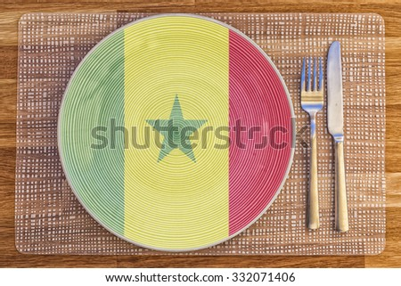 Dinner plate with the flag of Senegal on it for your international food and drink concepts. - stock photo