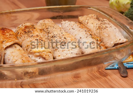 Dinner served. Meat rolls are in the casserole dish - stock photo