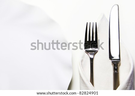 dinner setting. dish, knife and fork on a white background - stock photo