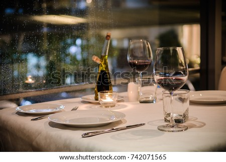 Dinner Table For Two Person With Plates, Spoon, Fork , Glasses Of Wine.