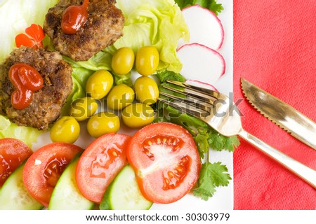 dinner with olives,tomatoes and cutlets