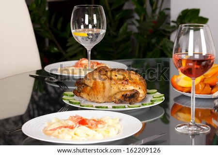Dinner with wine glasses and Roast chicken