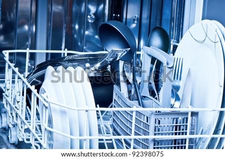 Dinnerware  inside  dishwasher - stock photo