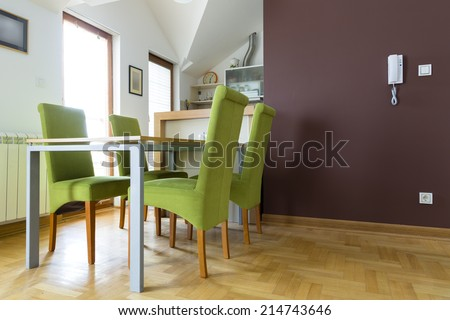 Dinning table in attic apartment - stock photo