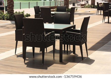 Dinning table set in openair cafe - stock photo