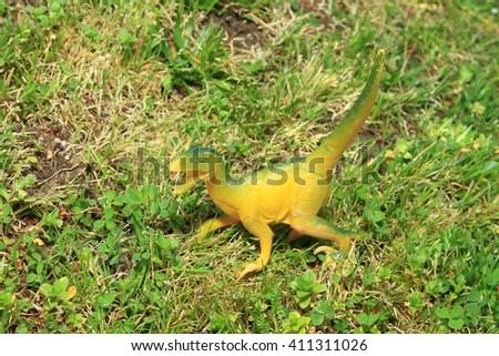 dinosaur in the grass - stock photo