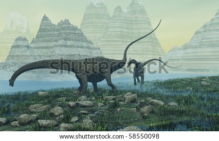 DIPLOCOCUS - Two Diplodocus dinosaurs munch on vegetation near a mountain lake. - stock photo