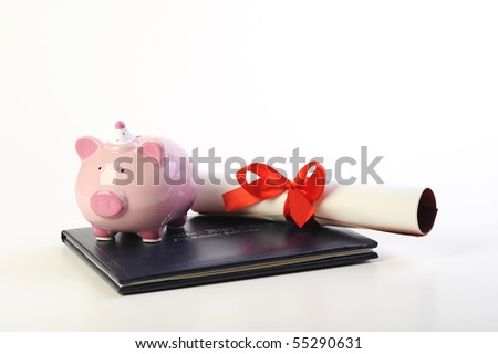 diploma and piggy bank isolated on white