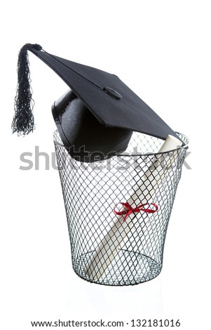 Diploma, Graduation hat inside a trashcan isolated on white - stock photo