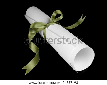 Diploma with a green silk ribbon, isolated on black background.