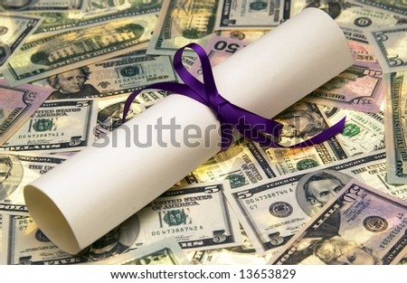 Diploma with money - stock photo