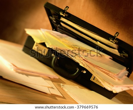Diplomat with papers - stock photo