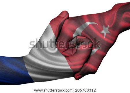 Diplomatic handshake between countries: flags of France and Turkey overprinted the two hands