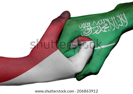Diplomatic handshake between countries: flags of Indonesia and Saudi Arabia overprinted the two hands - stock photo