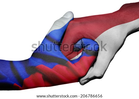 Diplomatic handshake between countries: flags of Russia and Indonesia overprinted the two hands - stock photo