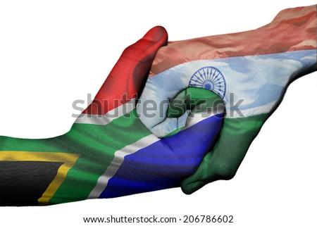 Diplomatic handshake between countries: flags of South Africa and India overprinted the two hands