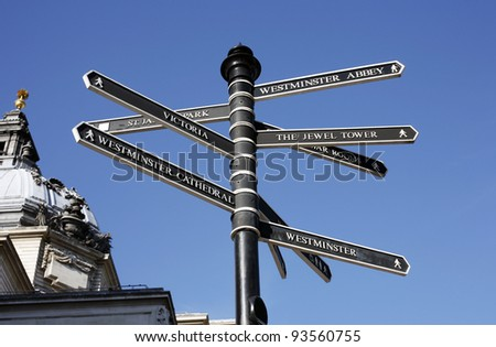 Direction guide post to famous landmarks and tourist sites in london - stock photo