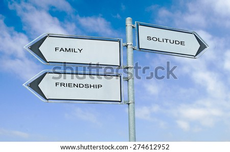 Direction road sign with  words family, friendship, solitude - stock photo