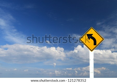 Direction sign- left turn warning on blue sky background with blank for text - stock photo