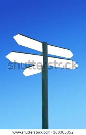 Direction signpost with blank direction arrows - stock photo