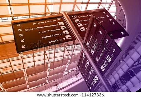 Direction signs in the modern airport - stock photo