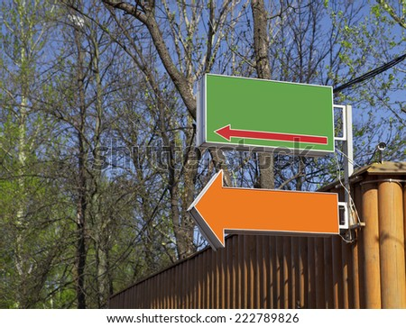 Direction signs on wood construction - stock photo