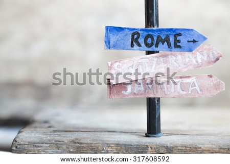 Direction to different places of the world. Rome, Switzerland, Jamaica. Travel background.  - stock photo