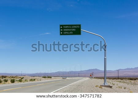 Directional road sign and blue sky at Pampa El Leoncito along the ruta 40 (Route 40) in San Juan Province. Argentina