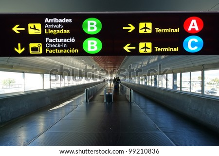 Directional sign in Barcelona International airport. Catalonia, Spain - stock photo