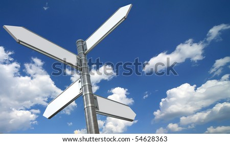 Directional signs over blue sky - stock photo