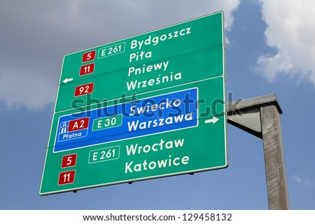 Directions sign in Poland showing directions to major city by national roads and a highway: Bydgoszcz, Pila, Warsaw, Wroclaw and Katowice. - stock photo