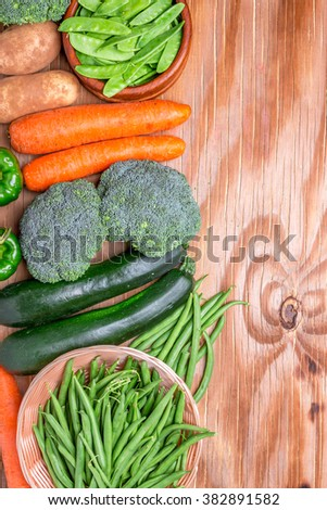 directly above overhead top view of group of vegetables on a wooden table with copy space for your art work
