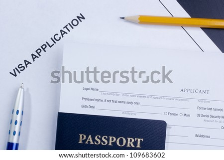 Directly above photograph of an application for a visa. - stock photo